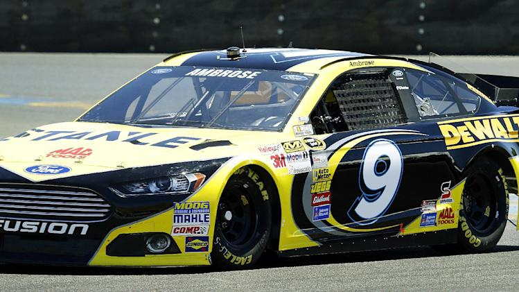 Marcos Ambrose, of Australia, races during qualifying laps for the NASCAR Sprint Cup Series auto race on Saturday, June 22, 2013, in Sonoma, Calif. (AP Photo/Ben Margot)