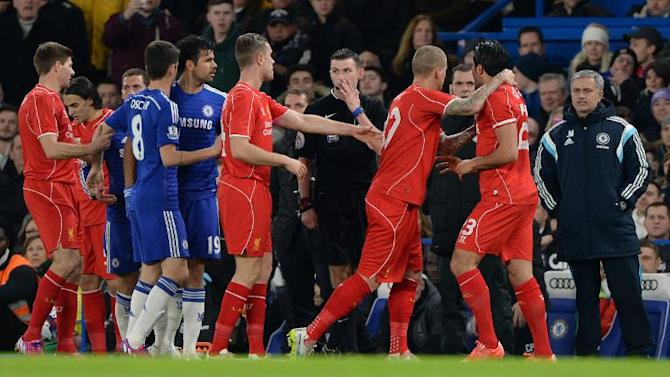 Liverpool's German midfielder Emre Can (R) is seperated from Chelsea's Brazilian-born Spanish striker Diego Costa (5L) as the pair confront each other after a challenge during their football match in London on January 27, 2015