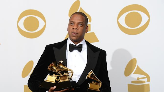 Rapper Jay-Z posing in the press room with his trophies at the Staples Center during the 55th Grammy Awards in Los Angeles, California, on February 10, 2013