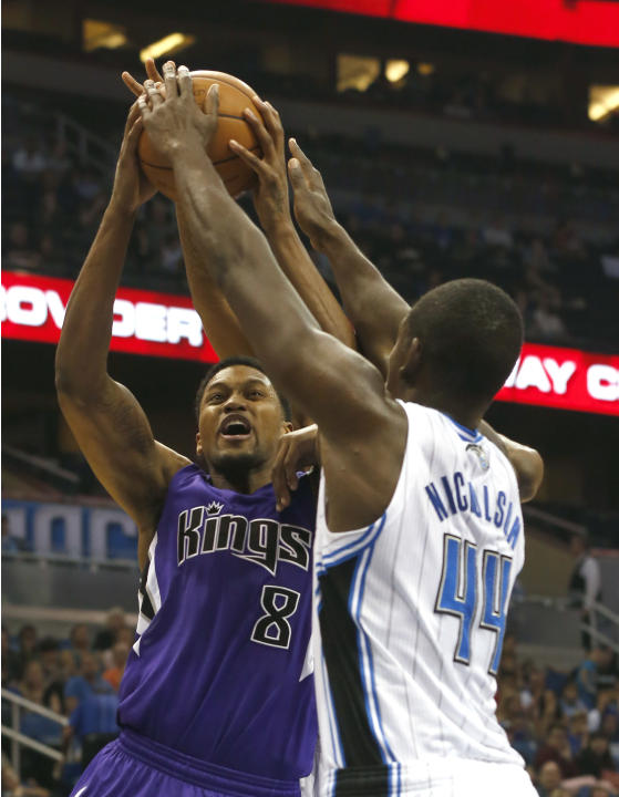 Orlando Magic  forward Andrew Nicholson (44) ties up Sacramento Kings forward Rudy Gay (8) during the first half of an NBA basketball game Saturday, Dec. 21, 2013, in Orlando, Fla. The Kings won 105-1