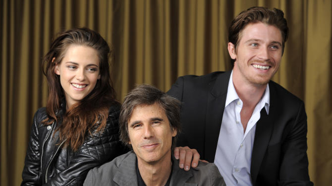 "Walter Salles, center, director of the film ""On the Road,"" poses with cast members Kristen Stewart, left, and Garrett Hedlund at the 2012 Toronto Film Festival, Saturday, Sept. 8, 2012, in Toronto. (Photo by Chris Pizzello/Invision/AP)"