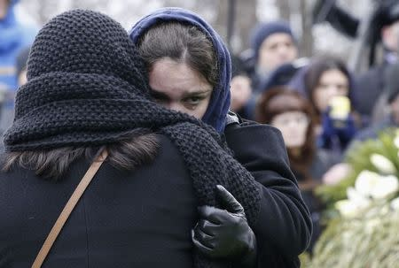 Zhanna, daughter of Russian leading opposition figure Boris Nemtsov, reacts during his funeral in Moscow