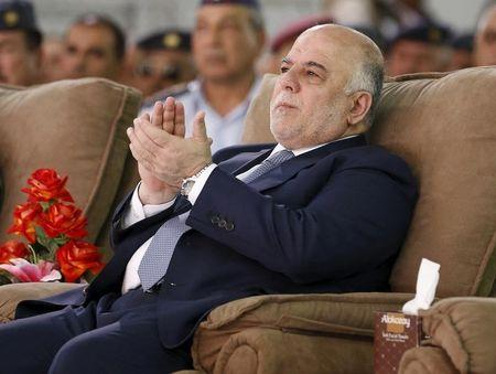 Iraq's Prime Minister Haidar al-Abadi attends an official ceremony to receive four F-16 fighter jets from the U.S., at a military base in Balad