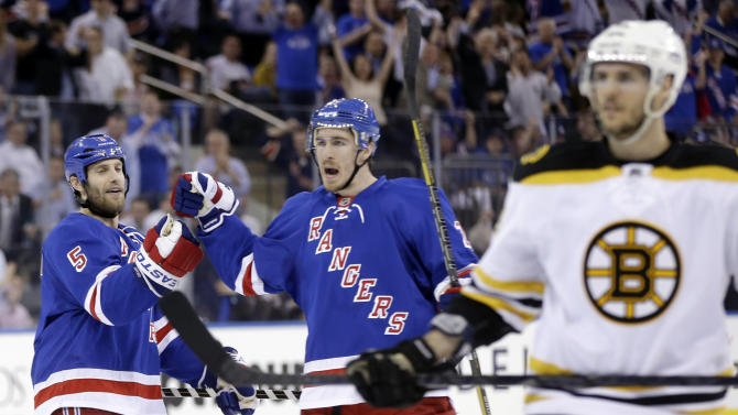 New York Rangers' Dan Girardi, left, and Ryan McDonagh celebrate after teammate Taylor Pyatt scored during the second period in Game 3 of the Eastern Conference semifinals in the NHL hockey Stanley Cup playoffs against the Boston Bruins in New York Tuesday, May 21, 2013, in New York. (AP Photo/Seth Wenig)