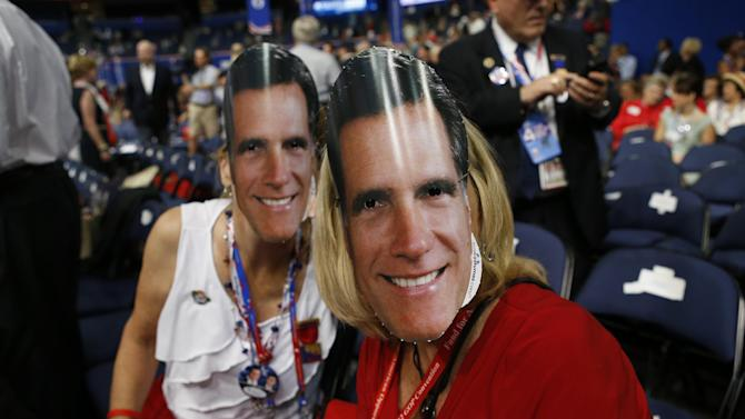 Michigan delegates Carol Knoblauch, left, and Barbara Brady fashion their masks of Republican presidential nominee Mitt Romney at the Republican National Convention in Tampa, Fla., on Thursday, Aug. 30, 2012. (AP Photo/Jae C. Hong)