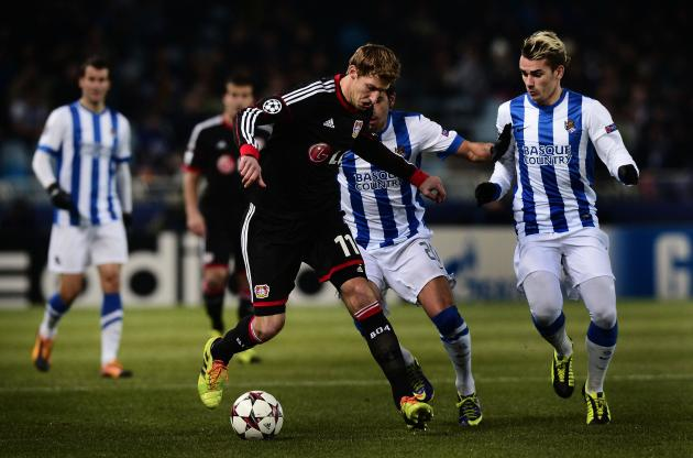 Real Sociedad's Antoine Griezmann and Jose Angel challenge Bayer Leverkusen's Stefan Kiessling during their Champions League soccer match at Anoeta stadium in San Sebastian
