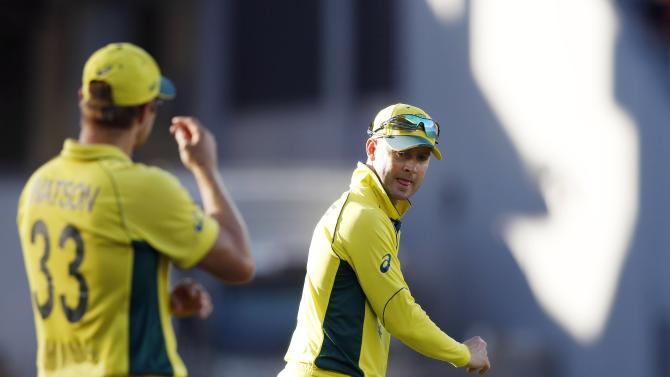 Australia's captain Michael Clarke chats with Shane Watson during their Cricket World Cup match against New Zealand in Auckland