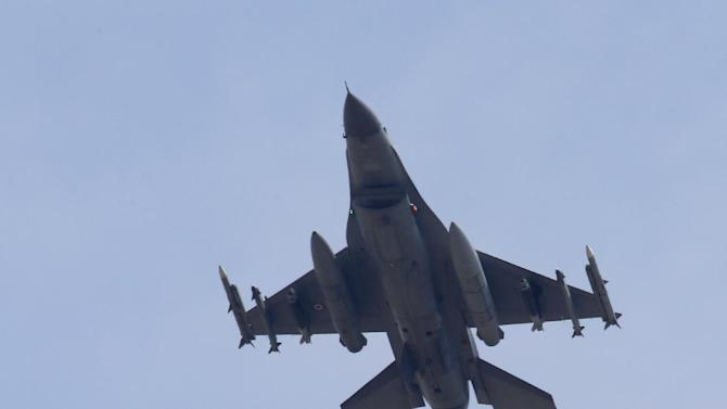 A missile-loaded Turkish Air Force warplane rises in the sky after taking off from Incirlik Air Base, in Adana, Turkey, Wednesday, July 29, 2015. After months of reluctance, Turkish warplanes last week started striking militant targets in Syria and agreed to allow the U.S. to launch its own strikes from Turkey's strategically located Incirlik Air Base. In a series of cross-border strikes, Turkey has not only targeted the IS group but also Kurdish fighters affiliated with forces battling IS in Syria and northern Iraq. (AP Photo/Emrah Gurel)