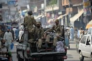 Pakistani soldiers ride on a pickup truck in Mingora, the capital of Swat valley, in 2011. The Taliban controlled much of Swat from 2007-2009 but were supposedly driven out by an army offensive in July 2009