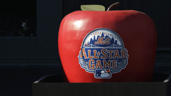 Players on the American League team pose for a group photo beneath the home run apple at Citi Field before the MLB All-Star baseball game, on Tuesday, July 16, 2013, in New York. (AP Photo/Matt Slocum)