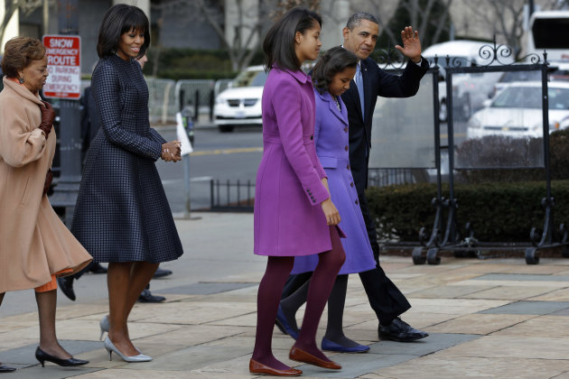 President Barack Obama, accompanied by his daughters Sasha and Malia, first lady Michelle Obama and mother-in-law Marian Robinson, waves as they arrive at St. John&#39;s Church in Washington, Monday, Jan. 21, 2013, for a church service during the 57th Presidential Inauguration. (AP Photo/Jacquelyn Martin)