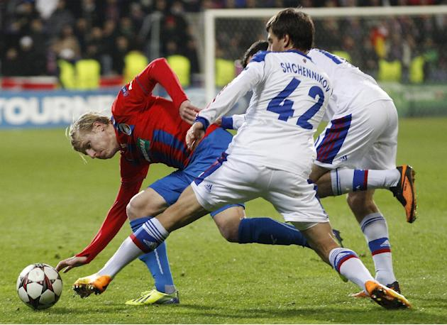 Moscow's Georgi Schennikov, right, challenges Viktoria Pilsen's Frantisek Rajtoral, left, during the Champions League Group D soccer match between Viktoria Pilsen and CSKA Moscow in Pilsen, Cz