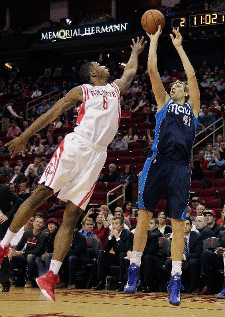 Dallas Mavericks forward Dirk Nowitzki (41), of Germany, shoots over Houston Rockets forward Terrence Jones (6)during the first half of an NBA basketball game, Monday, Dec. 23, 2013, in Houston