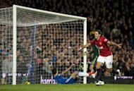 Manchester United&#39;s Mexican striker Javier Hernandez (L) celebrates after scoring their third goal during match against Chelsea at Stamford Bridge in London, on October 28, 2012. Manchester United won the game 3-2