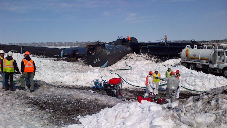 Train cars derail in Minnesota, spill crude oil