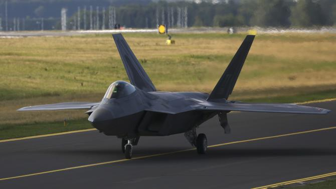 A U.S. Air Force F-22 Raptor fighter jet taxis on tarmac at the Spangdahlem Air base