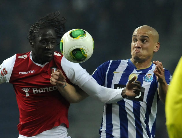 FC Porto's Maicon Roque, right, from Brazil vies with Sporting Braga's Eder Lopes, from Guinea-Bissau, in a Portuguese League soccer match at the Dragao Stadium in Porto, Portugal, Saturday, D