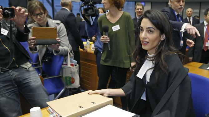 Human rights lawyer Alamuddin Clooney arrives with to attend a hearing at the European court of Human Rights in Strasbourg