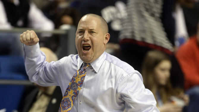 Marquette head coach Buzz Williams reacts in the first half of a third-round NCAA college basketball tournament game against Butler, Saturday, March 23, 2013, in Lexington, Ky. (AP Photo/John Bazemore)