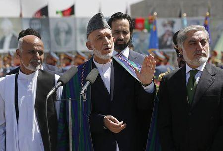 Afghan President Karzai, presidential candidates Abdullah and Ghani attend celebrations to commemorate Afghanistan's anniversary of independence in Kabul