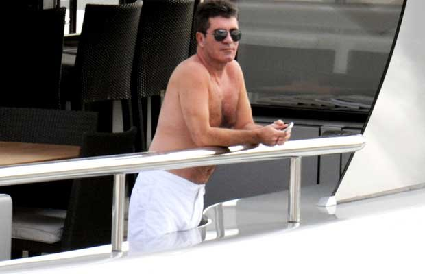 Simon Cowell takes in views of the harbor. PacificCoastNews.com