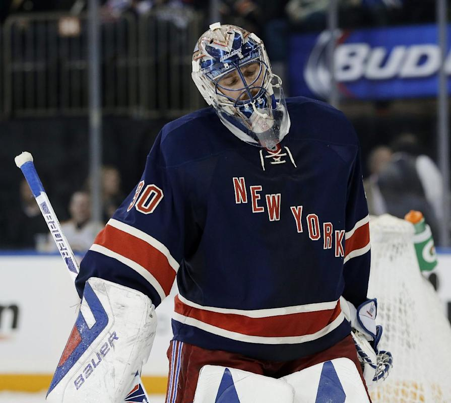 New York Rangers goalie Henrik Lundqvist reacts after being scored on by Boston Bruins' Milan Lucic during the third period of the NHL hockey game Sunday, March 2, 2014, in New York. The Bruins beat the Rangers 6-3