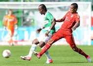 Bayern Munich's defender Luiz Gustavo (R) and Fuerth's Djiby Fall fight for the ball. Bayern opened their German league campaign with a comfortable 3-0 win at newly promoted Greuther Fuerth on the opening weekend of the Bundesliga's 50th season