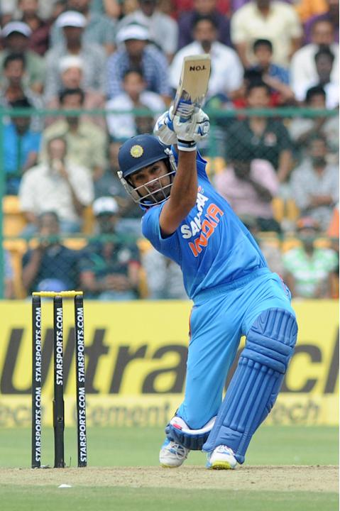 Indian player Rohit Sharma plays a shot during the 7th ODI between India and Australia played at Chinnaswamy Stadium in Bangalore on Nov.2, 2013. (Photo: IANS)
