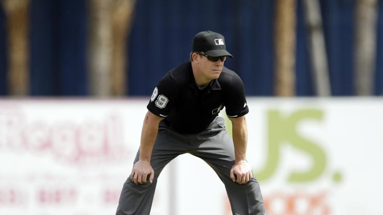 Umpire Toby Basner (99) is seen during the fifth inning of a spring exhibition baseball game between the Detroit Tigers and the Toronto Blue Jays in Lakeland, Fla., Tuesday, March 11, 2014. (AP Photo/Carlos Osorio)