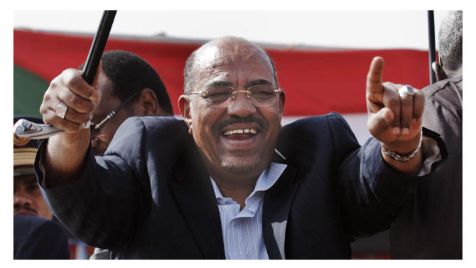 This combination image made from two file photos showing Sudanese President Omar al-Bashir, top, gesturing during a rally at El Negaa Stadium, El Fasher, North Darfur, Sudan Wednesday, Feb. 8, 2012, and photo below showing Kenya's President-Elect Uhuru Kenyatta waving to supporters after final election results were announced declaring he would be the country's next president, in Nairobi, Kenya Saturday, March 9, 2013.  A top Kenyan official said Monday April 8, 2013, that Sudanese President Omar al-Bashir is not traveling to Nairobi to attend Tuesday's presidential inauguration despite press reports to the contrary, adding that Sudan's government is invited but not al-Bashir. (AP Photo)