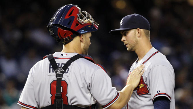 Atlanta Braves catcher David Ross (8) consoles starting pitcher Mike Minor during the fifth inning of their interleague baseball game against the New York Yankees at Yankee Stadium in New York, Monday, June 18, 2012. Minor left the mound in the sixth after giving up a solo home run to Yankees' Mark Teixeira. (AP Photo/Kathy Willens)