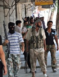 &lt;p&gt;Syrian opposition fighters besiege the Shaar district police station in the northern Syrian city of Aleppo which was later overrun by rebel forces July 25. Syrian rebels held off an offensive by regime forces in Aleppo as the head of the exiled opposition called for heavy weapons and said President Bashar al-Assad should be tried for &quot;massacres&quot;.&lt;/p&gt;
