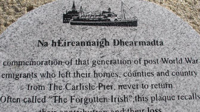 """This May 18, 2013 photo shows a plaque on Dun Laoghaire pier in Country Dublin, Ireland, dedicated to """"The Forgotten Irish"""" _ the thousands of young Irish who emigrated to Britain during hard times in the 1950s and 1960s. Many spent their working lives sending money to support their families in Ireland, yet were unable to afford to return themselves. As part of The Gathering, a yearlong event in Ireland to bring its diaspora home, a group of volunteers sponsored about 50 elderly emigrants on a weeklong visit, including an emotional wreath-laying ceremony next to a plaque in their honor on the pier. (AP Photo/Helen O'Neill)"""