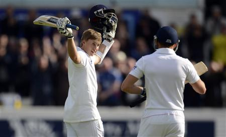 England's Root celebrates after reaching his first test century during the second test cricket match against New Zealand at Headingley cricket ground in Leeds