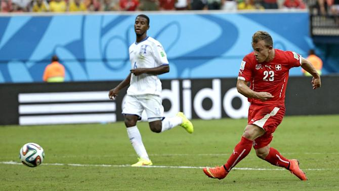 Switzerland's Xherdan Shaqiri (23) scores his teams second goal during the group E World Cup soccer match between Honduras and Switzerland at the Arena da Amazonia in Manaus, Brazil, Wednesday, June 25, 2014