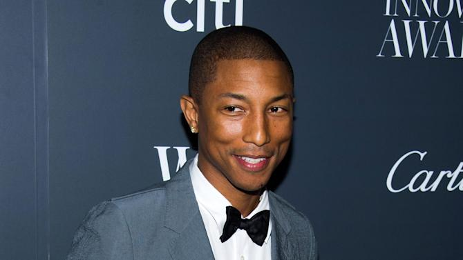 """FILE - In this Nov. 6, 2013 file photo, Pharrell Williams attends the WSJ. Magazine's Innovator Awards in New York. Williams' """"Happy,"""" from the """"Despicable Me 2"""" soundtrack, was nominated for an Academy Award for best original song on Thursday, Jan. 16, 2014 . The 86th Academy Awards will be held on March 2. (Photo by Charles Sykes/Invision/AP, File)"""