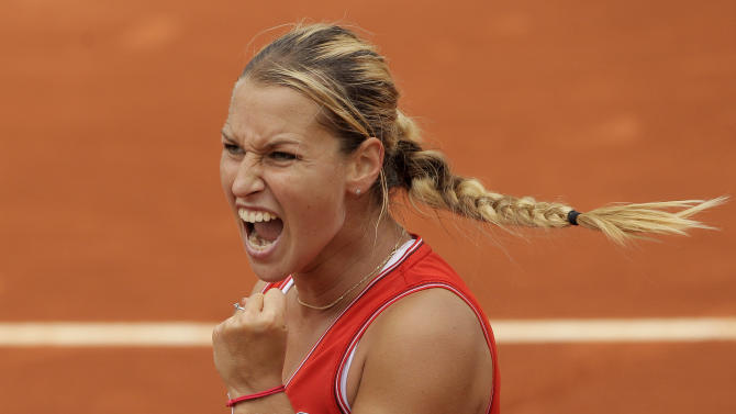 Slovakia's Dominika Cibulkova clenches her fist as she plays Belarus' Victoria Azarenka during their fourth round match in the French Open tennis tournament at the Roland Garros stadium in Paris, Sunday, June 3, 2012. Cibulkova won 6-2, 7-6.  (AP Photo/Michel Spingler)