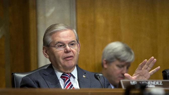 FILE - In this Jan. 9, 2014, file photo, Senate Foreign Relations Committee Chairman Sen. Robert Menendez, D-N.J., asks questions at a hearing on Capitol Hill in Washington, Thursday, Jan. 9, 2014. Menendez paid a law firm $250,000 in December 2013 for legal costs related to Justice Department and Senate Ethics Committee investigations into his ties with a major campaign donor. The Democrat also has set up a legal trust to raise money as the investigations continue. (AP Photo/Pablo Martinez Monsivais, File)
