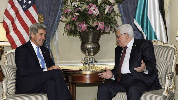 US Secretary of State John Kerry meets with Palestinian President Mahmud Abbas in London on September 8, 2013