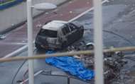 Debris and a burned out car are pictured at the scene of a helicopter crash in central London on January 16, 2013. Two people were killed after a helicopter hit a crane at a building site in central London and plunged to the ground in a ball of flames on Wednesday, police said