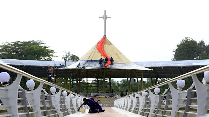 Workers are seen fixing floor tiles at Namugongo martyrs shrine in Uganda