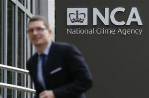 A man walks past the National Crime Agency headquarters in London