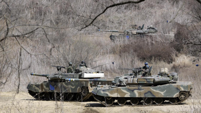 "South Korea's K-1 tanks take part in their military exercise in the border city between two Koreas, Paju, north of Seoul, South Korea, Friday, March 29, 2013. North Korean leader Kim Jong Un warned Friday that his rocket forces were ready ""to settle accounts with the U.S.,"" unleashing a new round of bellicose rhetoric after U.S. nuclear-capable B-2 bombers dropped dummy munitions in joint military drills with South Korea. (AP Photo/Lee Jin-man)"