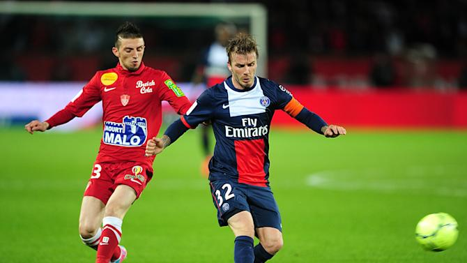 Beckham passes before coming under pressure from Stade Brestois' Abel Khaled. (Getty)