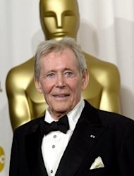 "File photo shows veteran Irish stage and screen actor Peter O'Toole next to the Oscar statue after receiving an honorary Academy Award in 2003. He received eight Oscar nominations during a career that also included noted roles in 1979's ""Caligula"" and ""The Last Emperor"", but never won the top prize itself"