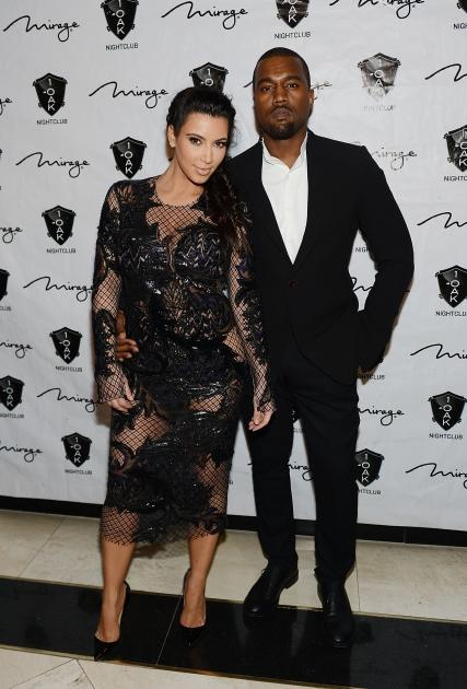A pregnant Kim Kardashian hits the red carpet with Kanye West for a New Year's Eve bash at 1 OAK Nightclub at the Mirage on December 31, 2012 in Las Vegas -- Getty Images