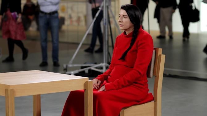 """In this 2010 photo released by Rio Film Festival, performance artist Marina Abramovic sits during the making of documentary film """"Marina Abramovic:The Artist is Present"""" in New York's Museum of Modern Art.  The Belgrade-born artist is best known for this piece which in 2010 saw her sit silent and motionless for 736.5 hours opposite a parade of strangers. The film is playing at the 2012 Rio de Janeiro International Film Festival. (AP Photo/Rio Film Festival)"""