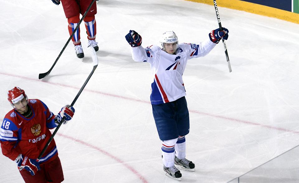 French Antoine Roussel, right, celebrates his goal during  the 2013 Ice Hockey IIHF World Championships preliminary round match Russia vs France in Helsinki, Finland on Thursday, May 9, 2013. At left is Russia's Yevgeni Biryukov. (AP Photo/LEHTIKUVA / Heikki Saukkomaa)  FINLAND OUT
