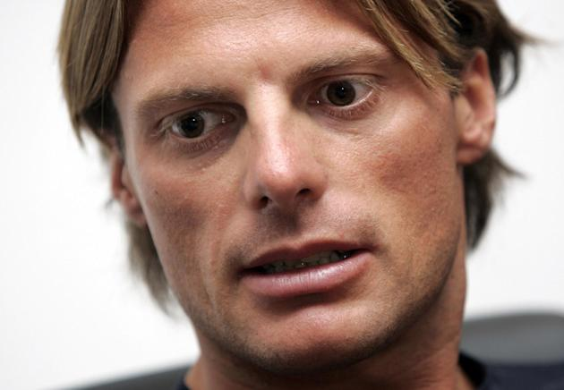 In this Aug. 26 2009 file photo Italian cyclist Danilo Di Luca looks on as he meets reporters after being heard by the Italian Olympic Committee (CONI) anti-doping prosecutors, at Rome's Olympic s