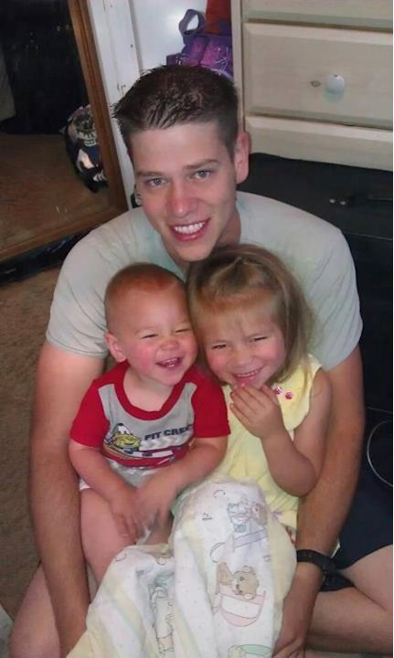 This undated photo provided by the family shows Jonathan T. Blunk, 26, of Aurora, Colo. with his two children. Blunk was one of the victims in the Friday, July 20, 2012 Aurora, Colo. movie theater sho